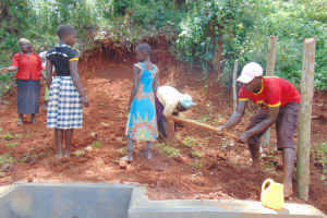 The Water Project: Jivovoli Community, Magumba Spring -  Planting Grass And Digging Fence Holes