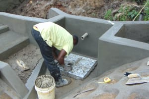 The Water Project: Buyangu Community, Mukhola Spring -  Tile Setting