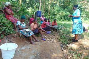 The Water Project: Bumira Community, Imbwaga Spring -  Training Begins With Facilitator Karen Maruti