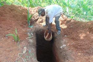 The Water Project: Kisasi Community, Edward Sabwa Spring -  Community Member Digging A Latrine Pit
