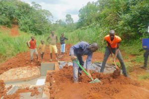 The Water Project: Shikhombero Community, Atondola Spring -  Backfilling With Soil