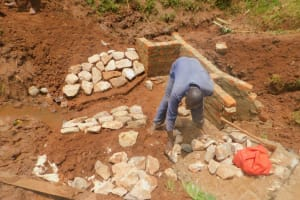 The Water Project: Busichula Community, Marko Spring -  Rub Wall Stone Pitching