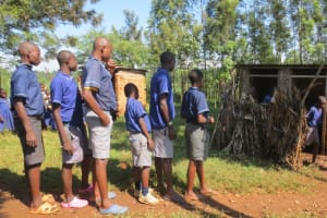 The Water Project: Mwikhupo Primary School -  Boys Lined Up To Use Latrines