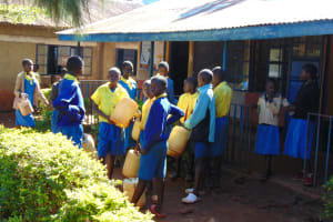 The Water Project: Gimomoi Primary School -  Students With Water Jerrycans Prepare To Fetch Water