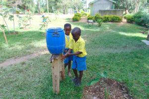 The Water Project: Shikomoli Primary School -  Pupils Use A Handwashing Station
