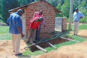 The Water Project: Kipchorwa Primary School -  School Management Checks Out Latrine Pit