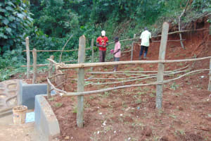The Water Project: Jivovoli Community, Magumba Spring -  Fencing