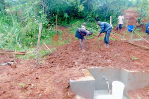 The Water Project: Shikhombero Community, Atondola Spring -  Planting Grass