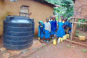 The Water Project: Kitagwa Primary School -  Students Fetching Water From A Nearby Home