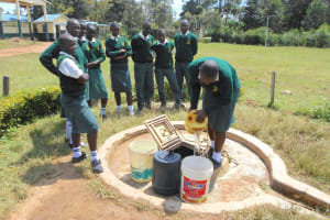 The Water Project: Friends School Manguliro Secondary -  Students Fetching Water From The Well