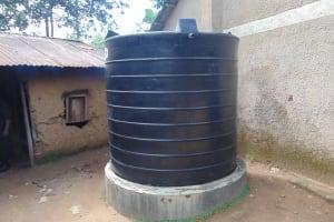 The Water Project: Shikomoli Primary School -  Small Plastic Rain Tank