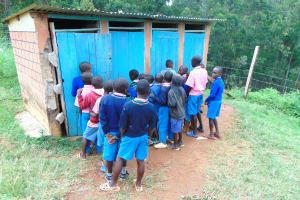 The Water Project: St. Joakim Buyangu Primary School -  Boys In Line For Latrines