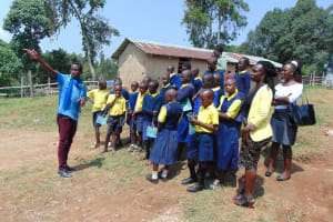The Water Project: Kosiage Primary School -  Field Officer Stanley Points Out Features Of The Rain Tank To Students