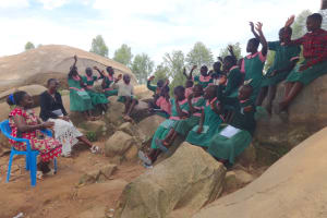The Water Project: Mwichina Primary School -  Students Respond To Trainer Marys Question