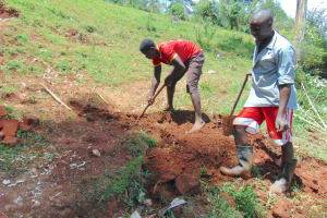 The Water Project: Jivovoli Community, Magumba Spring -  Digging Cut Off Drainage