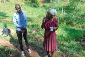 The Water Project: Bumira Community, Imbwaga Spring -  A Woman Demonstrates Toothbrushing