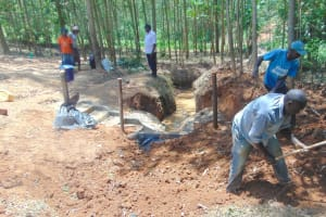 The Water Project: Shivembe Community, Murumbi Spring -  Adding Soil Over Tarp