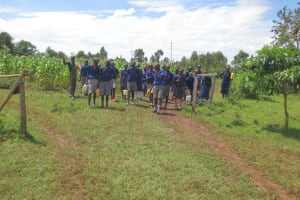 The Water Project: Mwikhupo Primary School -  Pupils Arrive Carrying Water Containers