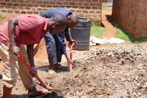 The Water Project: Banja Secondary School -  Mixing Concrete Tank Foundation