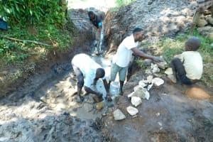 The Water Project: Imbinga Community, Imbinga Spring -  Laying Stones For The Foundation