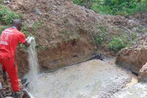 The Water Project: Kimarani Community, Kipsiro Spring -  Adding To The Foundation