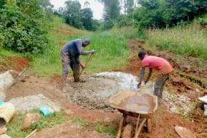 The Water Project: Shikhombero Community, Atondola Spring -  Mixing Concrete