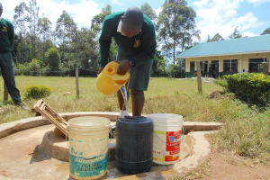 The Water Project: Friends School Manguliro Secondary -  Fetching Water From The Well