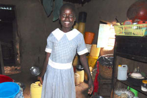 The Water Project: Saosi Primary School -  Student Collecting Water From Home