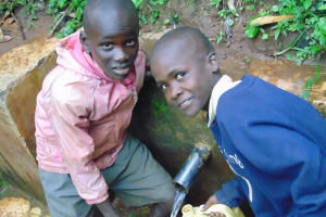 The Water Project: Kapsegeli KAG Primary School -  Students Fetching Water At The Spring