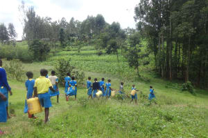 The Water Project: Isikhi Primary School -  Pupils Head To The Spring For Water