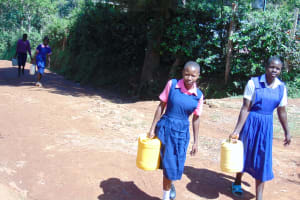 The Water Project: Gimengwa Primary School -  Students Carry Water To School