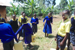 The Water Project: Jimarani Primary School -  Pupils Bring Water To Kitchen