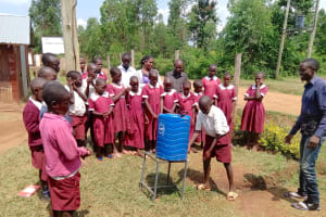 The Water Project: Mulwanda Mixed Primary School -  Student Tries Out The Handwashing Station