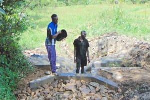 The Water Project: Buyangu Community, Mukhola Spring -  Backfilling