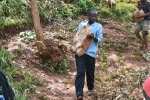 The Water Project: Busichula Community, Marko Spring -  Community Members Carry Large Stones To The Spring Site