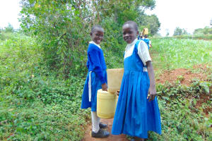 The Water Project: Jamulongoji Primary School -  Pupils Sharing Water On Way From Spring