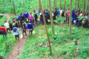 The Water Project: Kapsegeli KAG Primary School -  Students Wait In Line For Water At The Spring