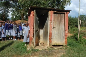 The Water Project: St. Martin's Primary School -  Girls Queueing At Their Pit Latrines