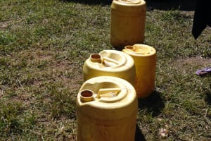 The Water Project: Gimengwa Primary School -  Water Jugs Left Out For Use At School
