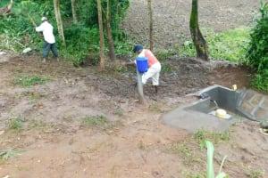 The Water Project: Imbinga Community, Imbinga Spring -  Backfilling With Soil