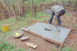 The Water Project: Jivovoli Community, Magumba Spring -  Sanitation Platform Construction