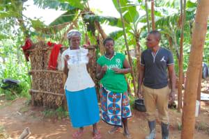 The Water Project: Kimarani Community, Kipsiro Spring -  Community Members Help Explain A Topic With Trainer Samuel Simidi