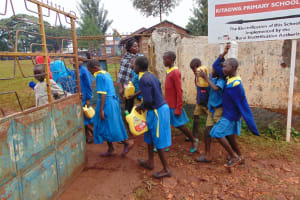 The Water Project: Kitagwa Primary School -  Students Return To School With Water