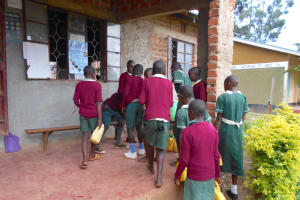 The Water Project: Wavoka Primary School -  Students Consolidate Water At The Administration Block