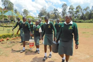 The Water Project: Friends School Manguliro Secondary -  Students Carrying Water From The Well