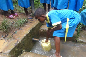 The Water Project: Isikhi Primary School -  A Girl Fetching Water