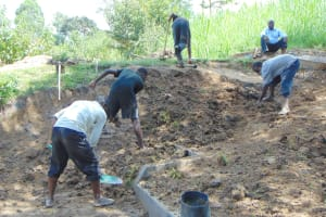 The Water Project: Buyangu Community, Mukhola Spring -  Backfilling With Soil Over Tarp