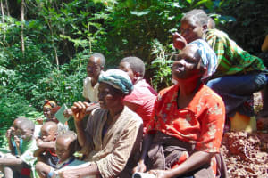 The Water Project: Kisasi Community, Edward Sabwa Spring -  Participants Watch And Imitate Toothbrushing