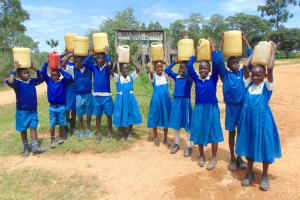 The Water Project: Jamulongoji Primary School -  Students With Water At School Entrance
