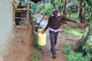 The Water Project: Friends Musiri Secondary School -  Student Carrying Water From Home